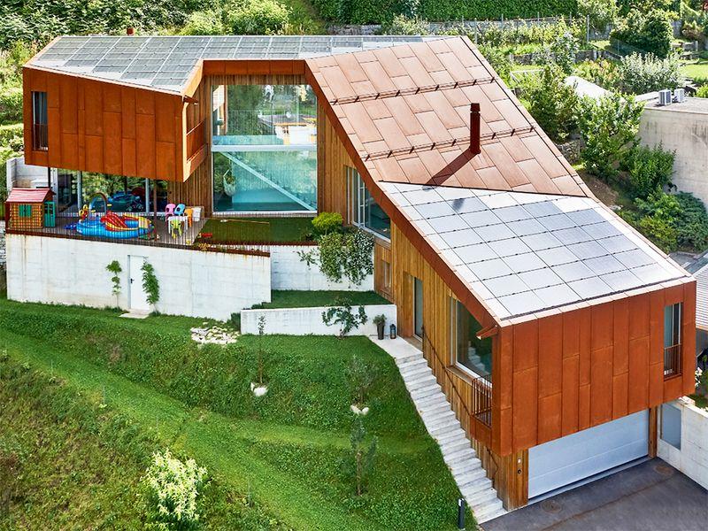 Plusenergie-Einfamilienhaus in Harmonie mit der Landschaft